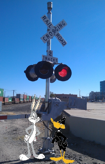 Bugs Bunny and Daffy Duck at Railroad Crossing with modern flashing light signal