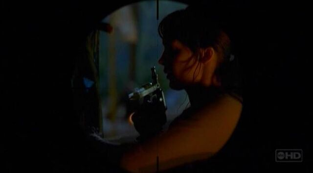 File:3x22 Others Woman w Injection Gun.jpg