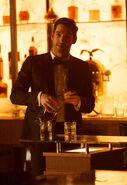 111 promo Lucifer pours drink
