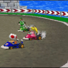 Peach, Yoshi, Luigi, and Toad, racing on the track.