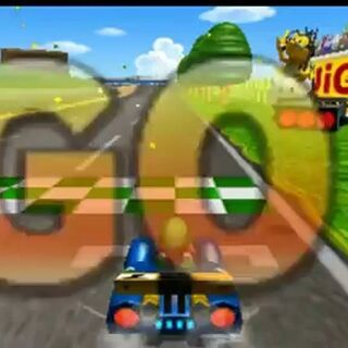 The start of the race at Luigi Raceway in <i>Mario Kart 7</i> with Luigi and Lakitu.