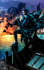 Nightwing holds Batman's cape and cowl