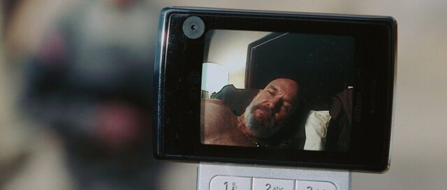 File:Obadiah-Stane-Bed-Phonecall.jpg