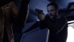 Lance-Hunter-aims-gun-at-Ward