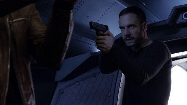 File:Lance-Hunter-aims-gun-at-Ward.jpg