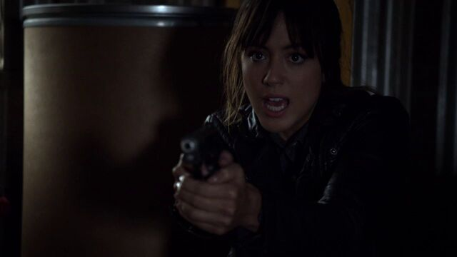 File:Skye-threatens-Coulson-gun-WritingOnTheWall.jpg
