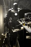 Anthony Stark and Iron Man Armor MK I (Earth-199999) from Iron Man (film) 0001