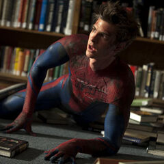 An unmasked Peter in a library.