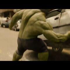 Hulk grabbing a car.