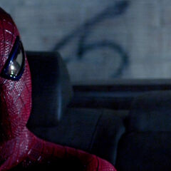 Spider-Man in the back of a car that is about to be stolen.