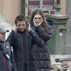 Jeremy Renner and Elizabeth Olsen on set