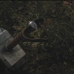 Mjölnir in a forest in <i>The Avengers</i>.