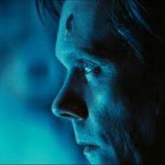 Shaw dies as Magneto's coin splits through his head.