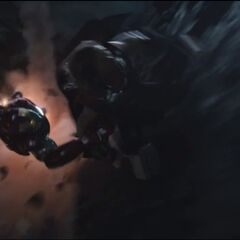 Thor and Iron Man fighting.
