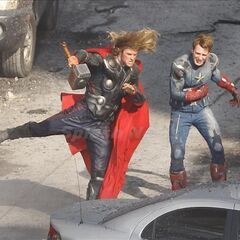 Chris Hemsworth and Chris Evans on set in costume.