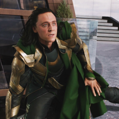Loki gets assaulted by the Hulk.