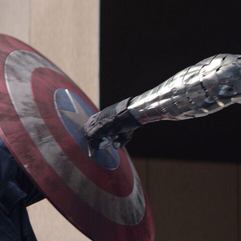 Captain America's shield colliding with  the Winter Soldier's arm