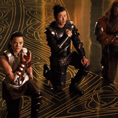 Sif and the Warriors Three kneel before Loki