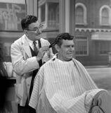Promo behind Floyd Andy cut hair