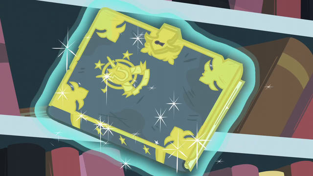 File:Trotter's Tome of Reliquary levitated out of the bookshelf S6E2.png