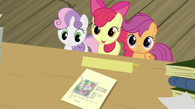 File:CMC showing the paper with Spike's photo S2E23.png