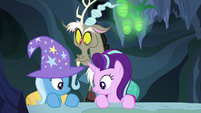 Starlight, Trixie, and Discord look down at Thorax S6E26