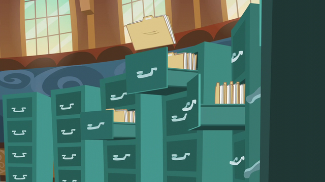 File:Files being thrown into drawers S5E19.png