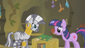 Twilight looks at the book that contains the remedy S1E09.png
