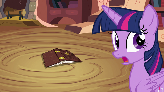 File:Twilight Sparkle about to pick up book S4E09.png
