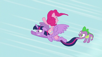 Twilight flying with Pinkie Pie on her back S5E12