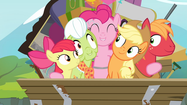 File:Pinkie Pie hugging all of the Apples S4E09.png