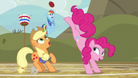 Pinkie Pie bucks the ball toward Rainbow S6E18
