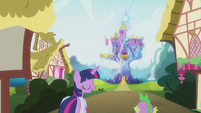 Twilight and Spike walk toward the castle S5E25