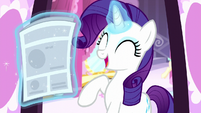 Rarity levitates newspaper S6E9