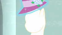 Rarity levitates a hat off of a mannequin S6E9