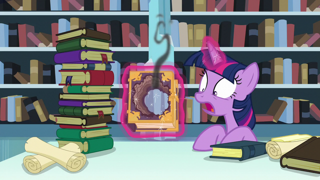 File:Twilight shocked by the hole formed on the tome S6E2.png