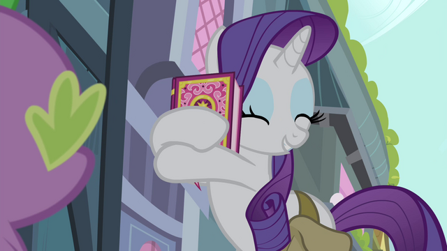 File:Rarity hugging the book S4E23.png