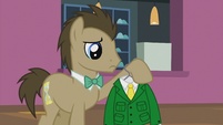 Dr. Hooves looks at his shirt S5E9