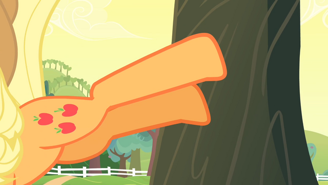 File:Applejack bucking the apple tree S4E07.png