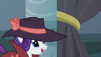 Rarity looks at the velvet rope-holder S5E15
