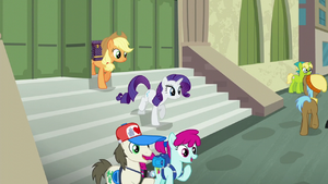 Applejack and Rarity exit the train station S5E16