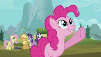 Pinkie Pie points up towards the sky S2E02