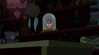 The Alicorn amulet sitting on the shelf S3E5