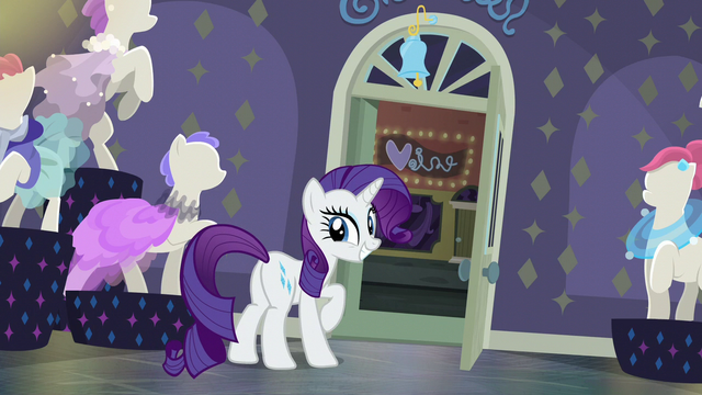 File:Rarity happy with the jingle bell S6E9.png