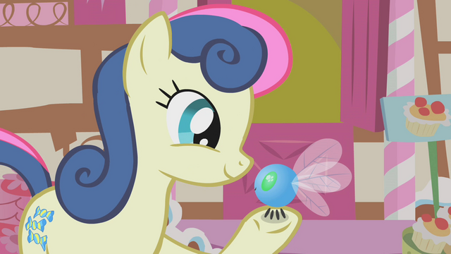 File:Sweetie Drops looks holds a parasprite in her hoof S1E10.png
