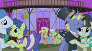 Applejack and Granny Smith looking at ponies dancing S4E13.png