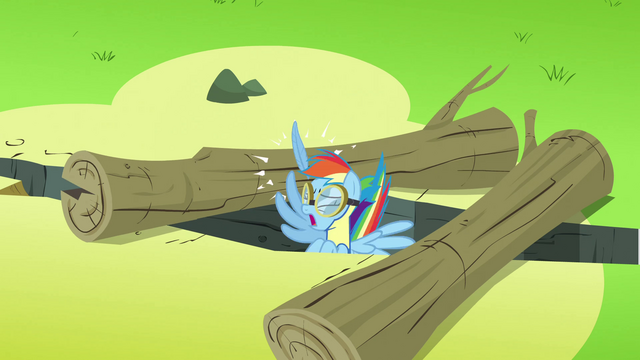 File:Rainbow Dash hurting herself while going between 2 logs S3E7.png