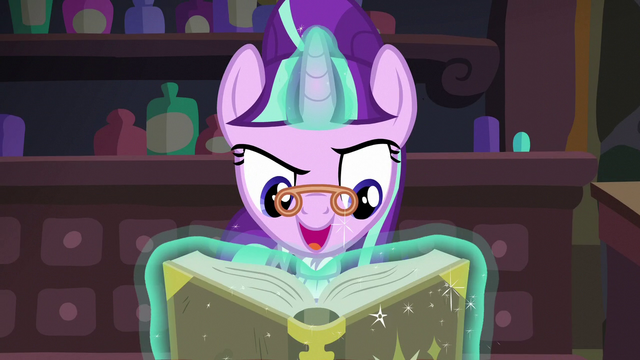File:Snowfall looks at her book S06E08.png