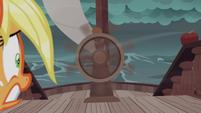 Applejack looks at spinning steering wheel S6E22