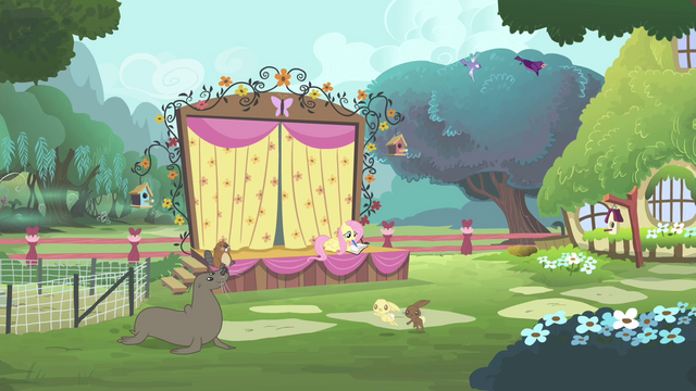 File:Fluttershy on the stage writing on the journal S4E14.png